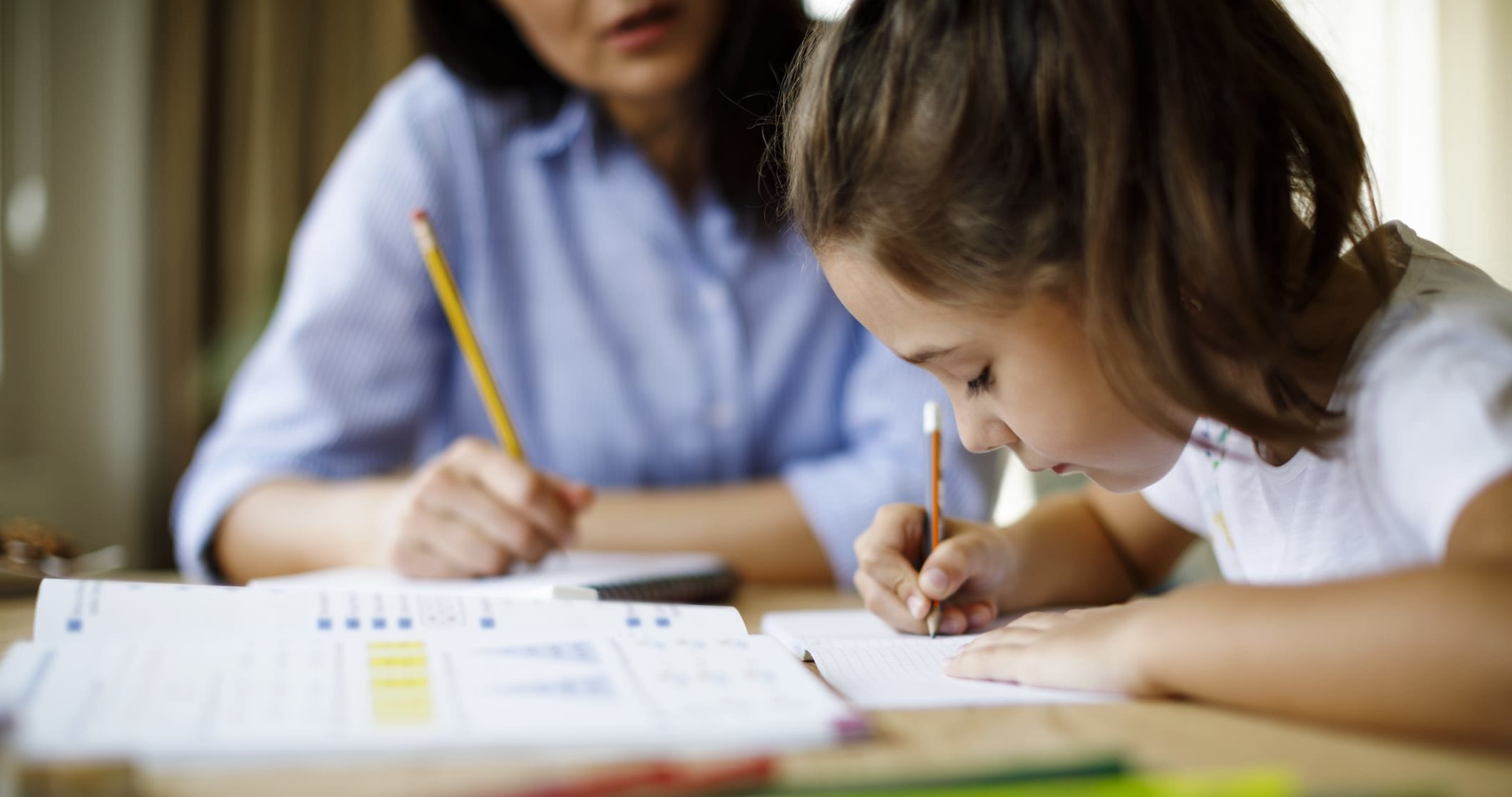 Mother helping daughter with homework - C4L